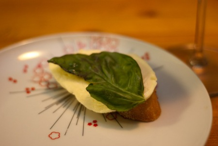 Cheese, artichoke, wine night: mozzarella and basil
